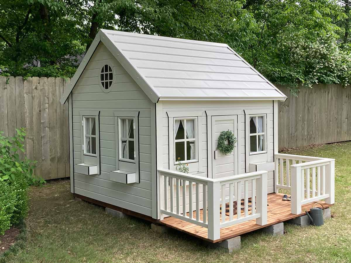 Custom wooden playhouse  with wooden terrace in garden |white outdoor playhouse by WholeWoodPlayhouses