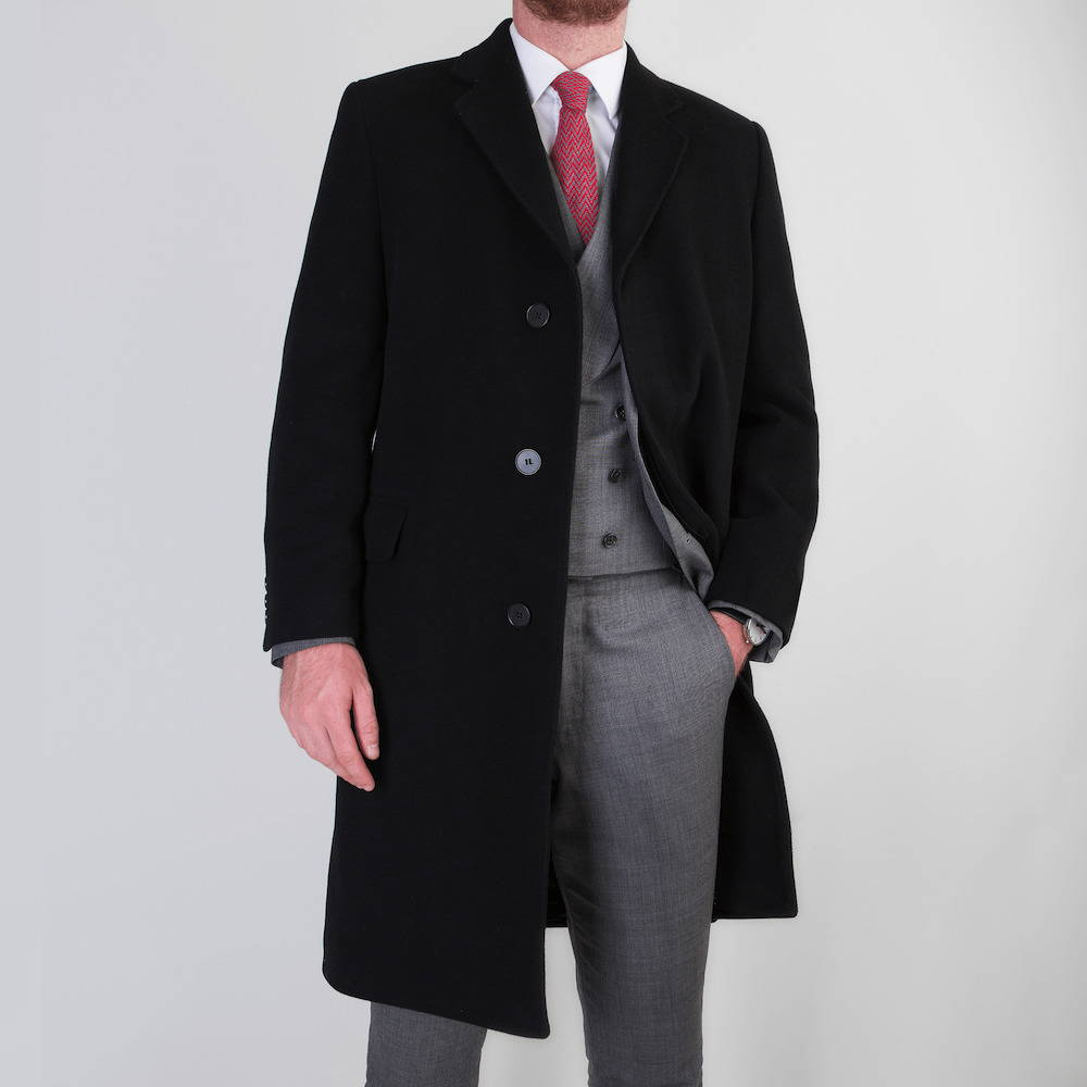 Model wearing bespoke overcoat atop bespoke tailored business suit by Mullen & Mullen bespoke tailoring
