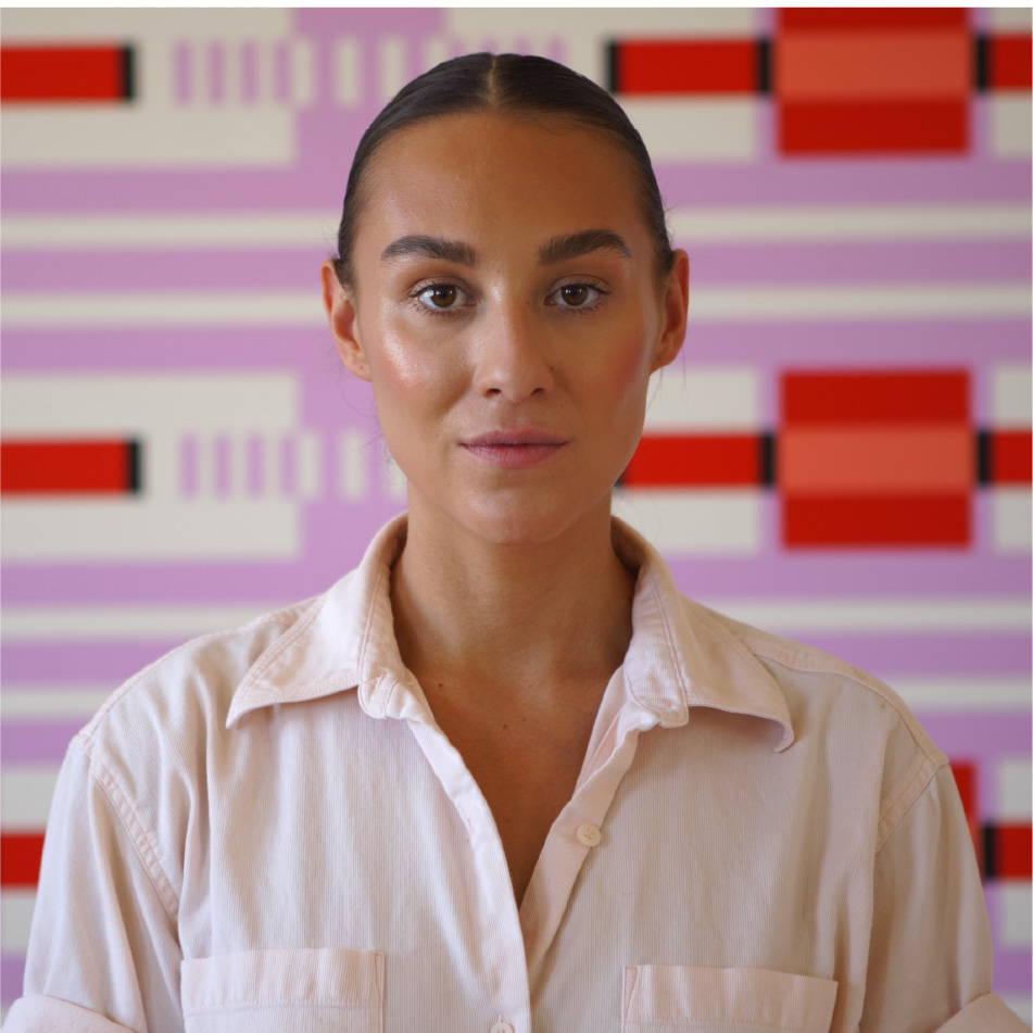 Jordan Ann Craig portrait in front of purple painted canvas