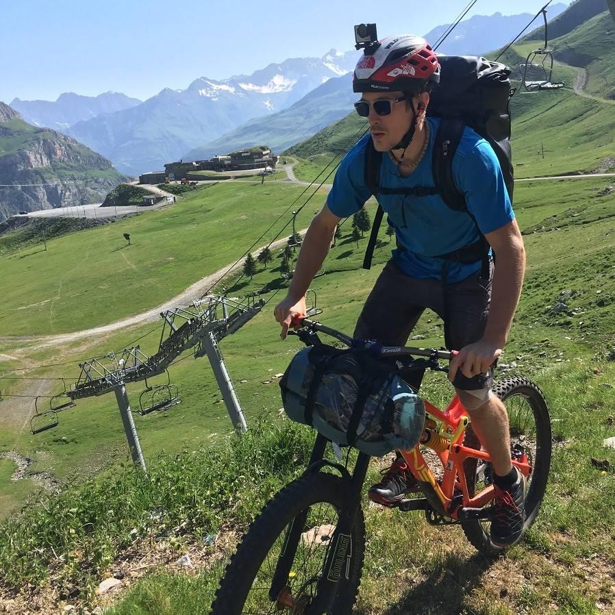 James Pearson riding his mountain bank and gear to the climbing crag