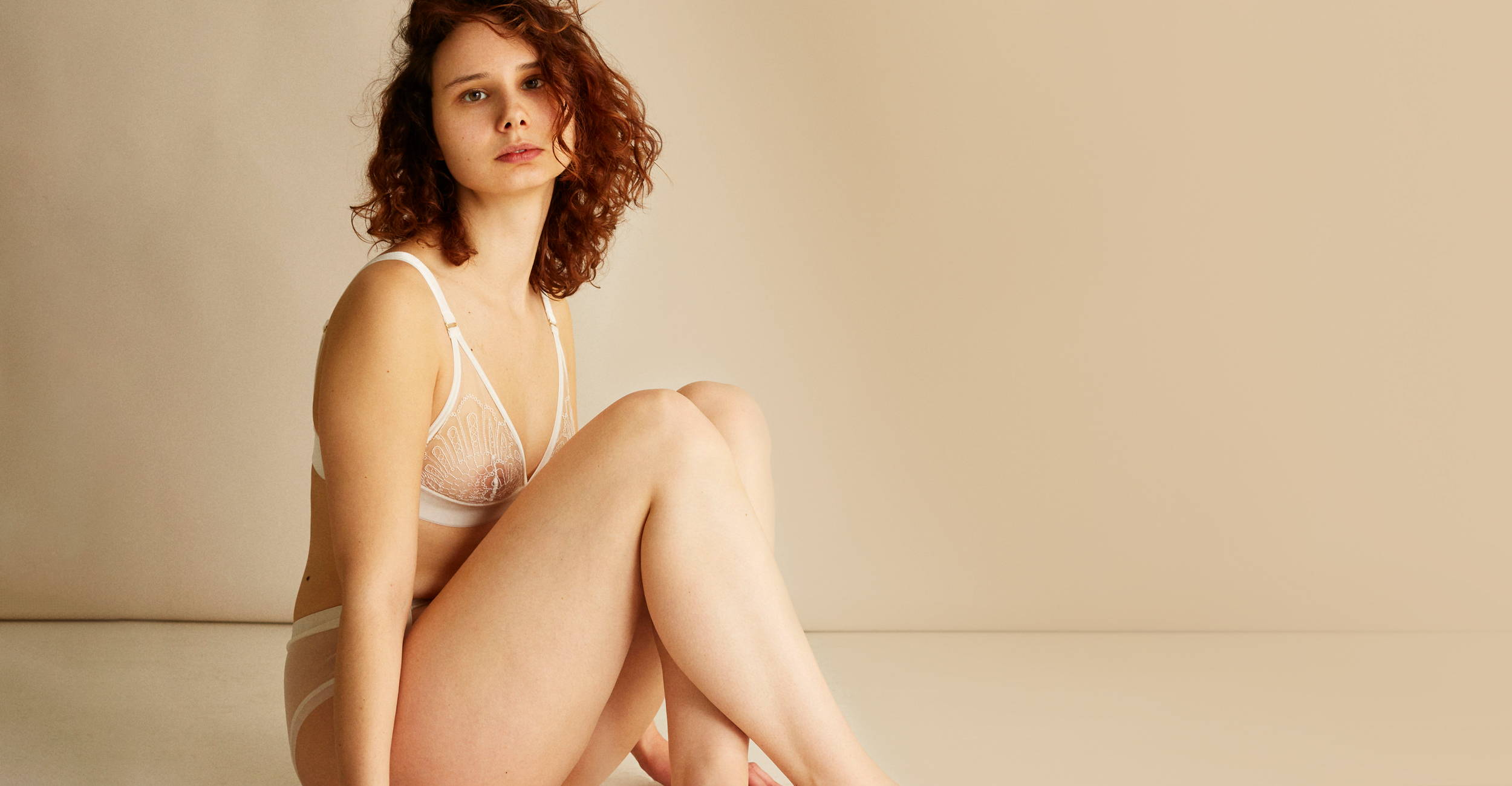 Woman wearing The Underargument For Love Against Conforming Triangle Bra and bottom lingerie set