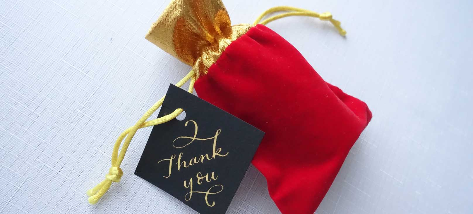 Thank you gold on black card wedding favour with calligraphy