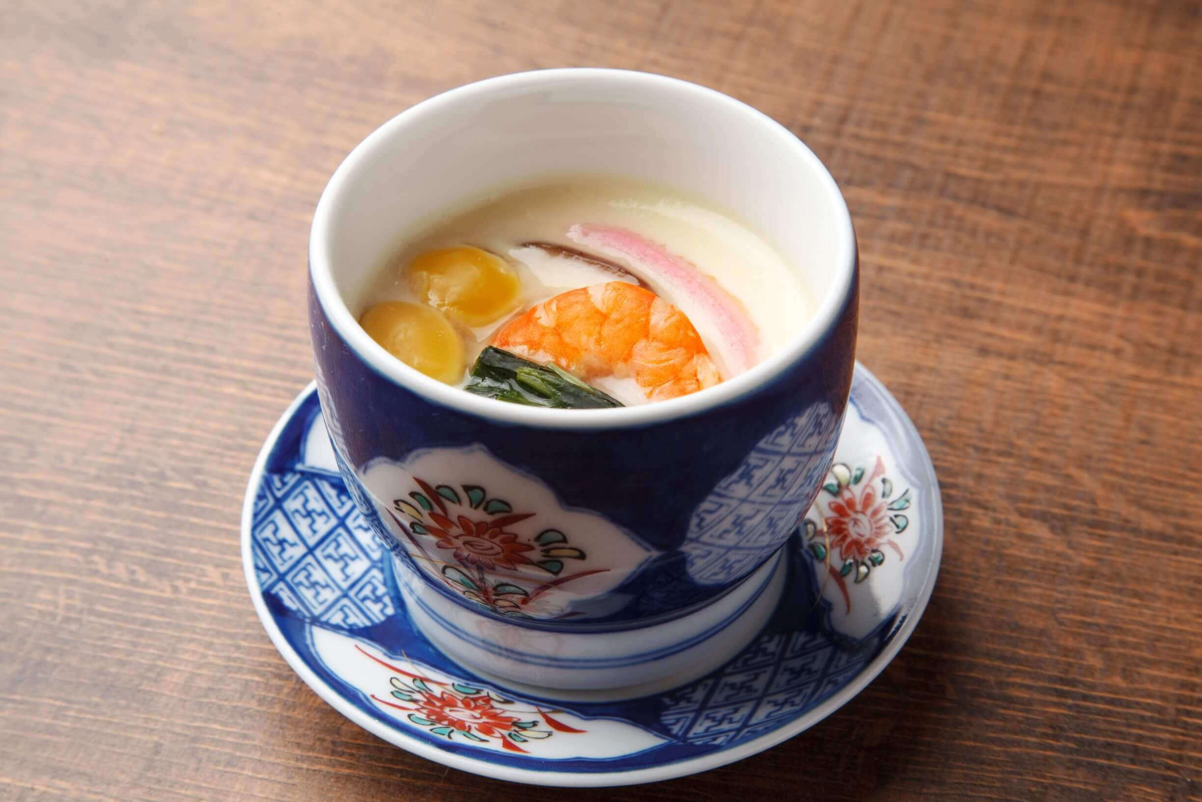 A tea cup filled with steamed egg
