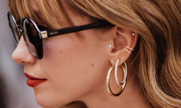 Close-up of Models ear wearing Ring Concierge earrings