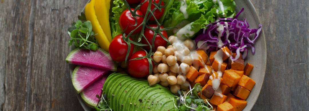 A vegan salad of avocado, chick peas, pumpkin, lettuce, peppers and more