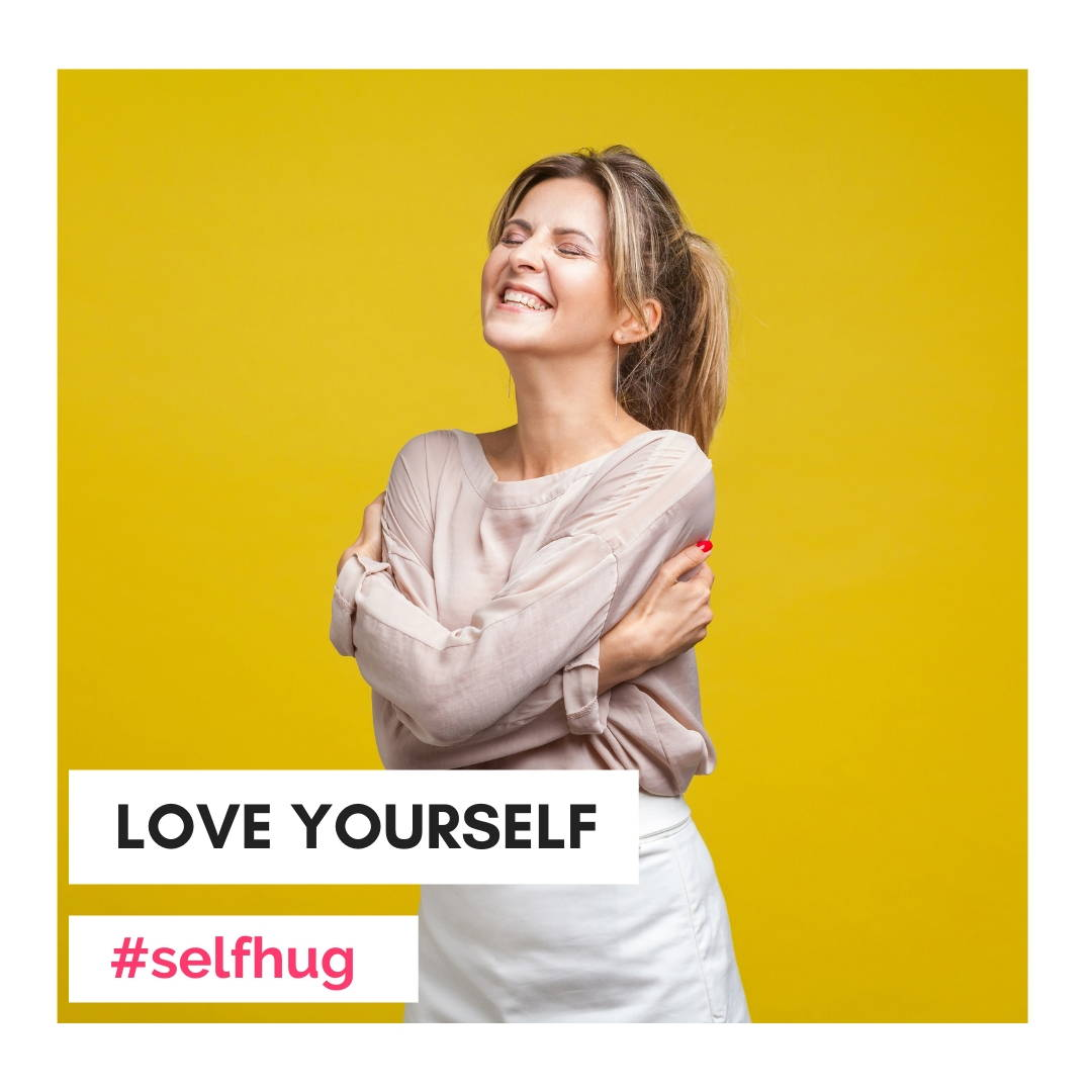 Woman self hug. It's important to take care of yourself first in order to be the best version of yourself.