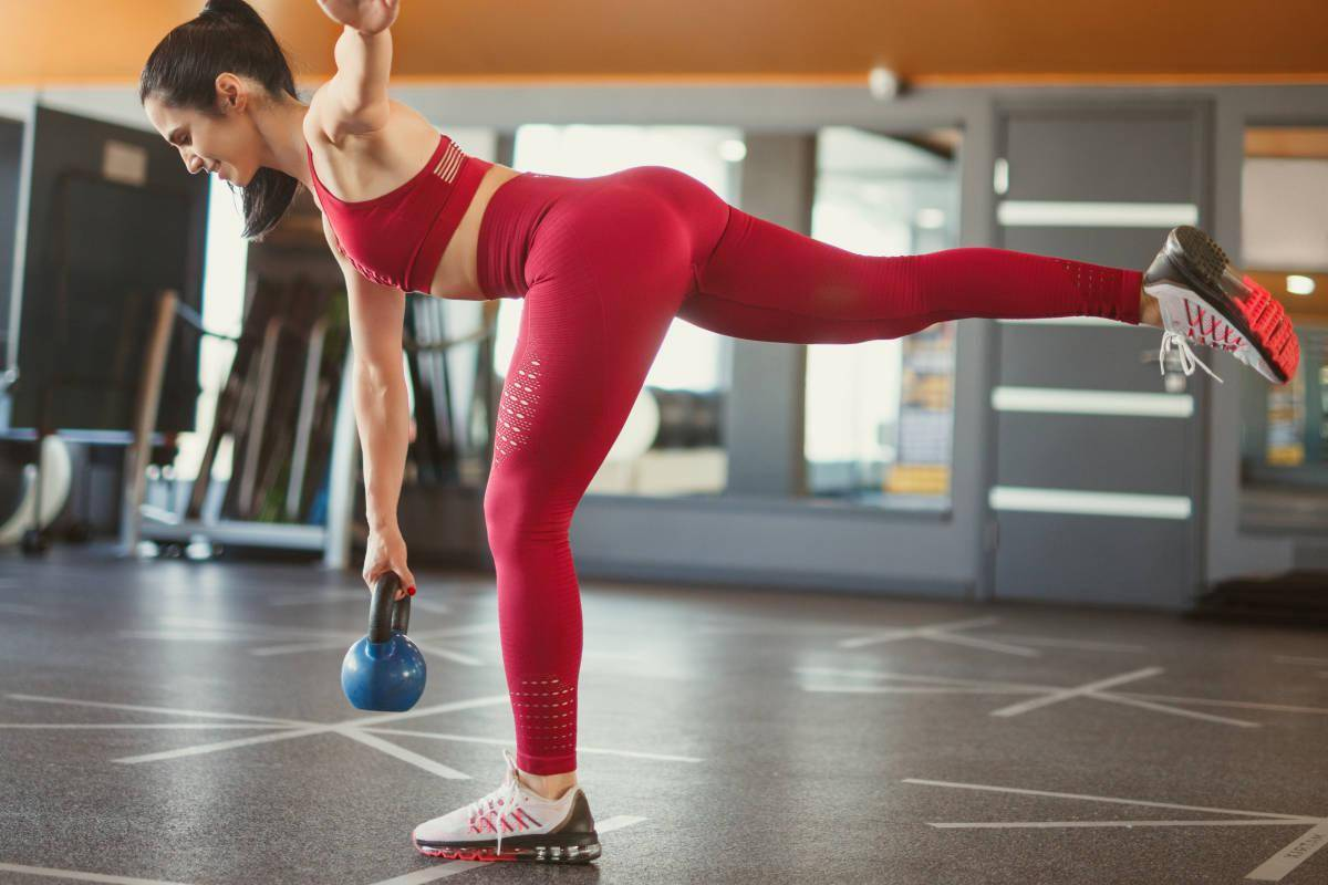 Featured   Young beauty girl do exercises at the stadium   Best Superset Hamstring Exercises You Need To Try