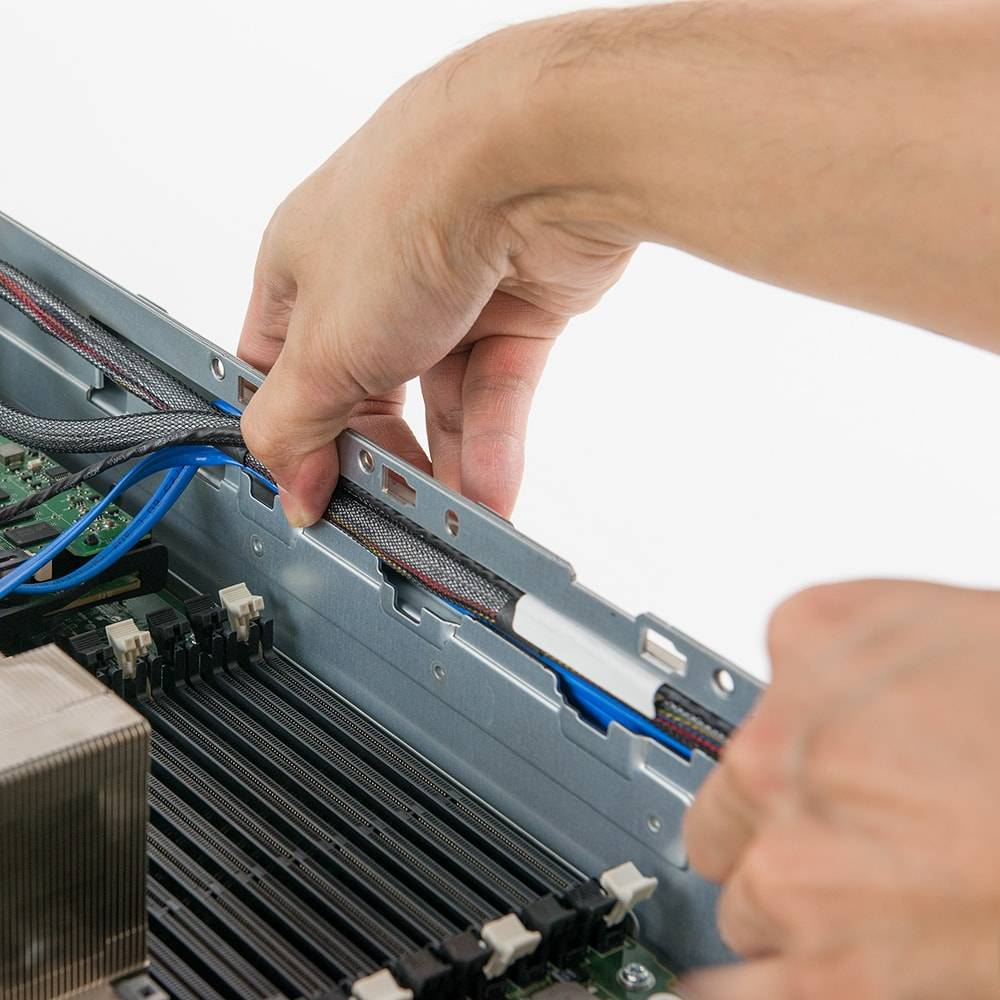 Rerouting a cable in the Dell PowerEdge R710 server