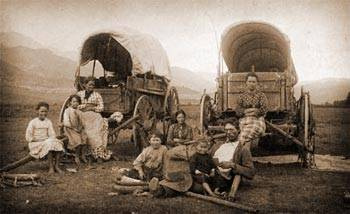 Oregon California Trail Emigrant Family with their covered wagons