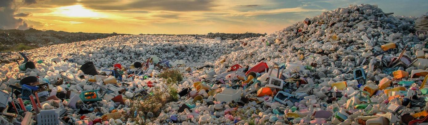 A huge pile of plastic waste on a beach. This beach is in need of a large scale beach clean up!