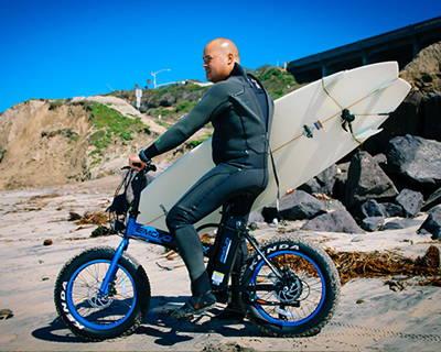 An Emojo Lynx electric bike hitting the beach.