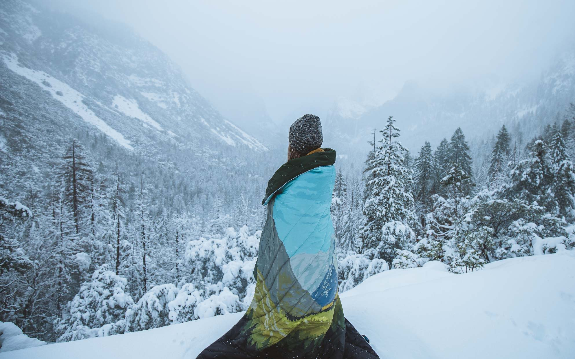 girl standing with original puffy blanket yosemite design by icon sierra Nevada valley
