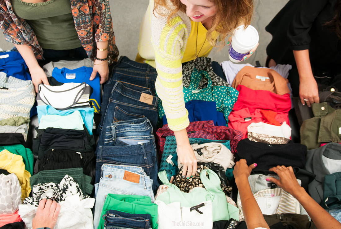 Work colleagues take part in a clothing swap event