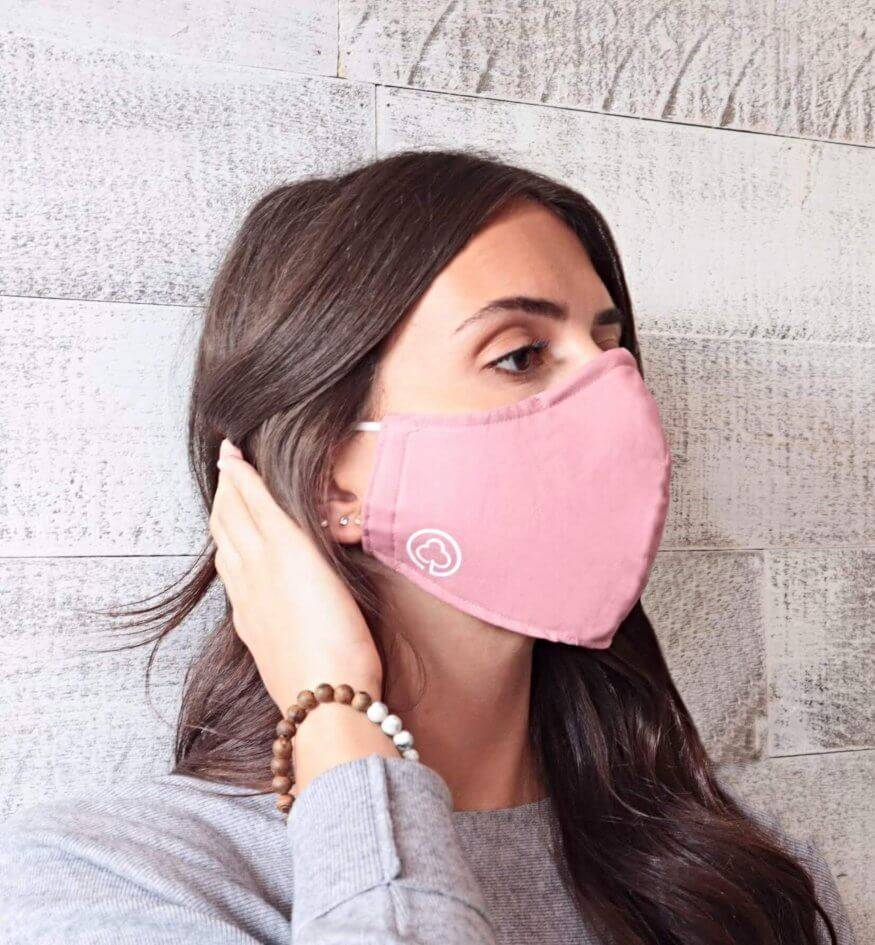 Woman wearing Adjustable, Breathable and Reusable Cotton Face Mask in Pink