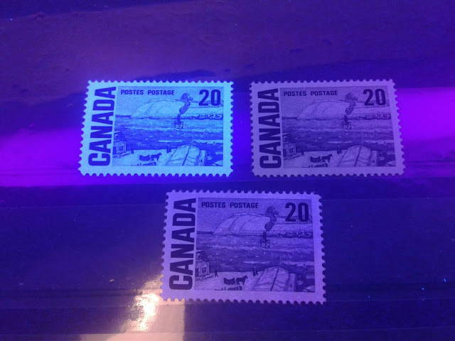 Three different paper types of the 20c Centennial issue of Canada as seen under ultraviolet light
