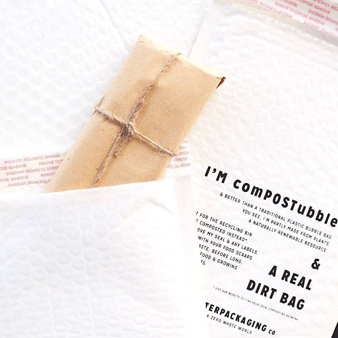 Paper Pens Co. shipping materials featuring biodegradable plastic envelopes