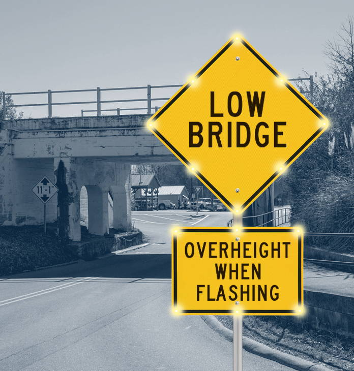 Low-bridge-ahead-overheight-when-flashing-blinkersign