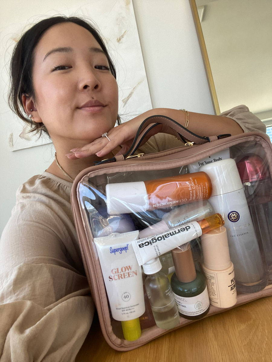 Jeannie with the CALPAK Clear Cosmetics Case in Caramel.