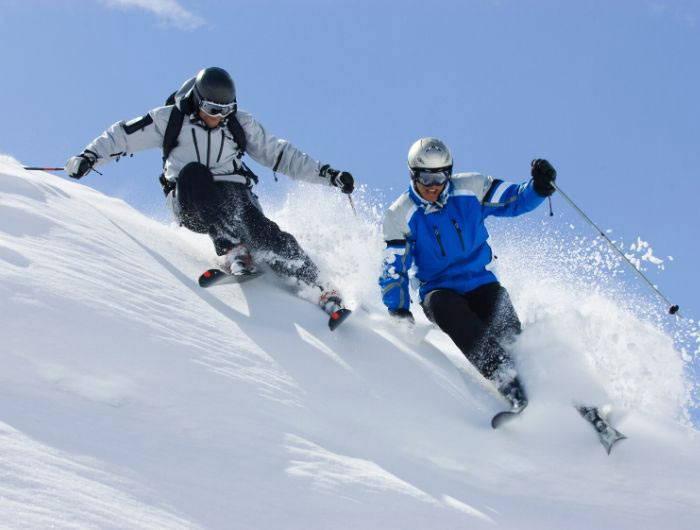 Two men skiing down mountain