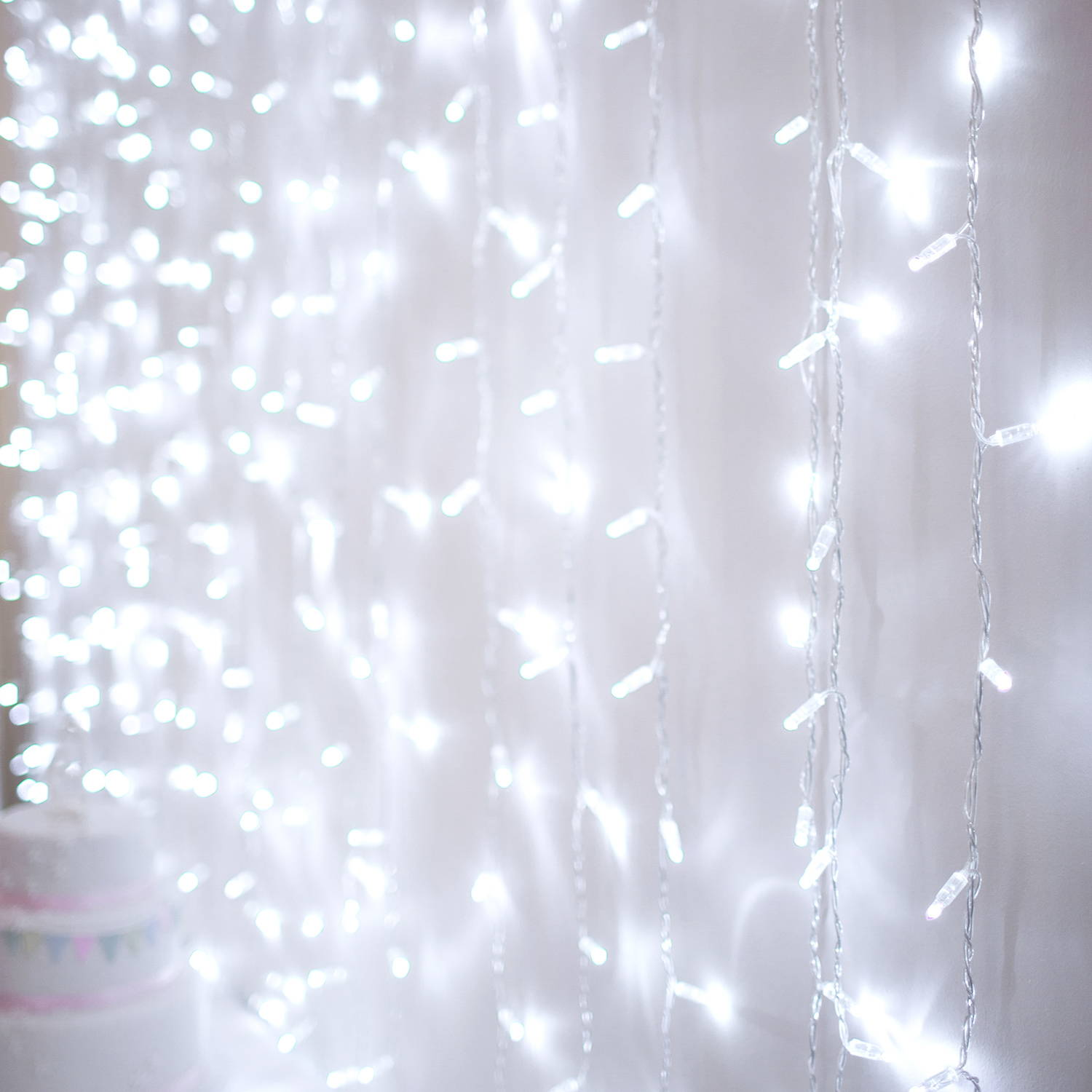A close up of an ice white curtain light on a neutral background
