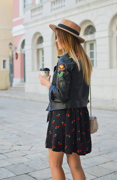 blonde balayage girl wearing a hat  and holding coffee cup
