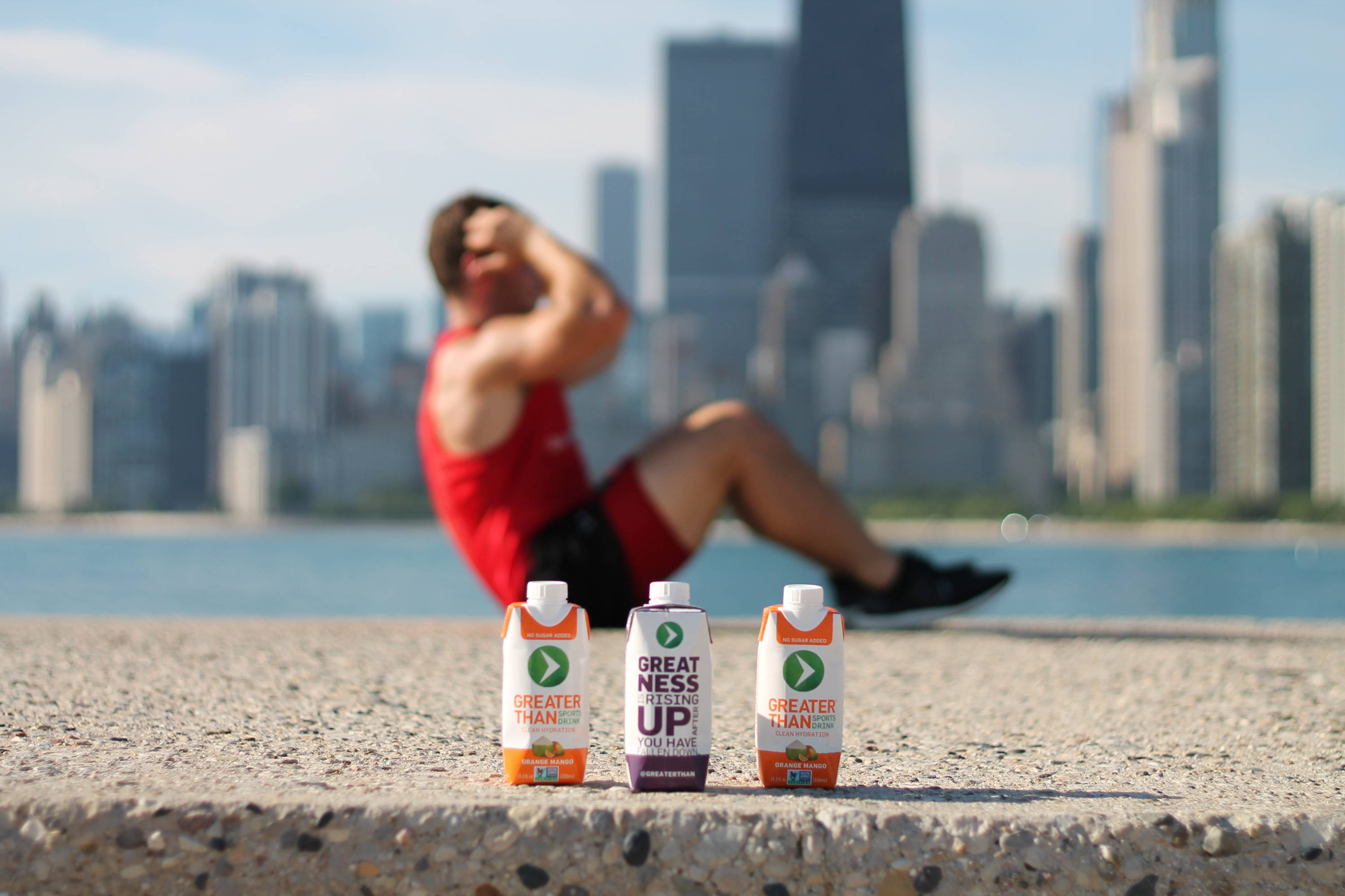 the valiant athlete battling extreme heat & exhaustion, reaching for the sports drink