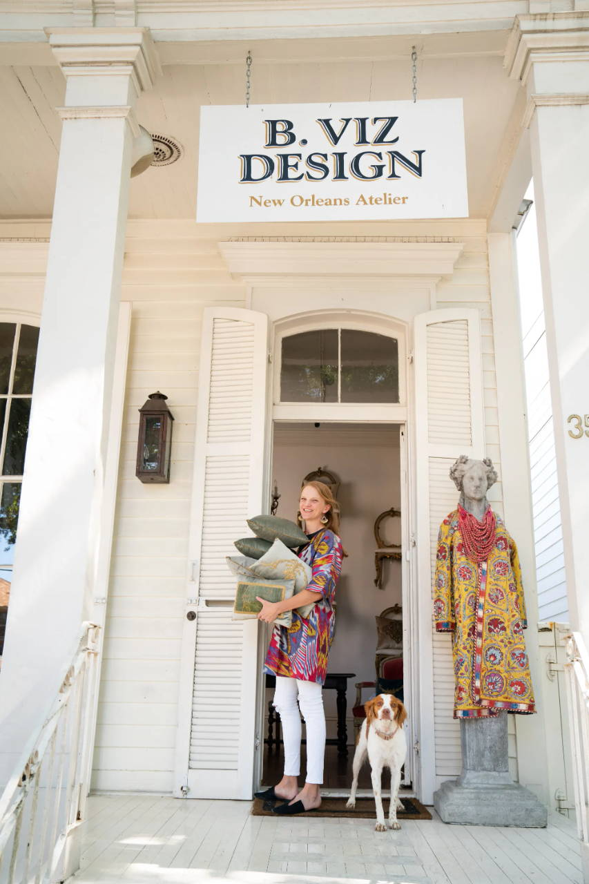 Sarah Vizard and Birdie the shop dog stand outside B. Viz Design NOLA Atelier on beautiful Magazine Street in New Orleans, LA.