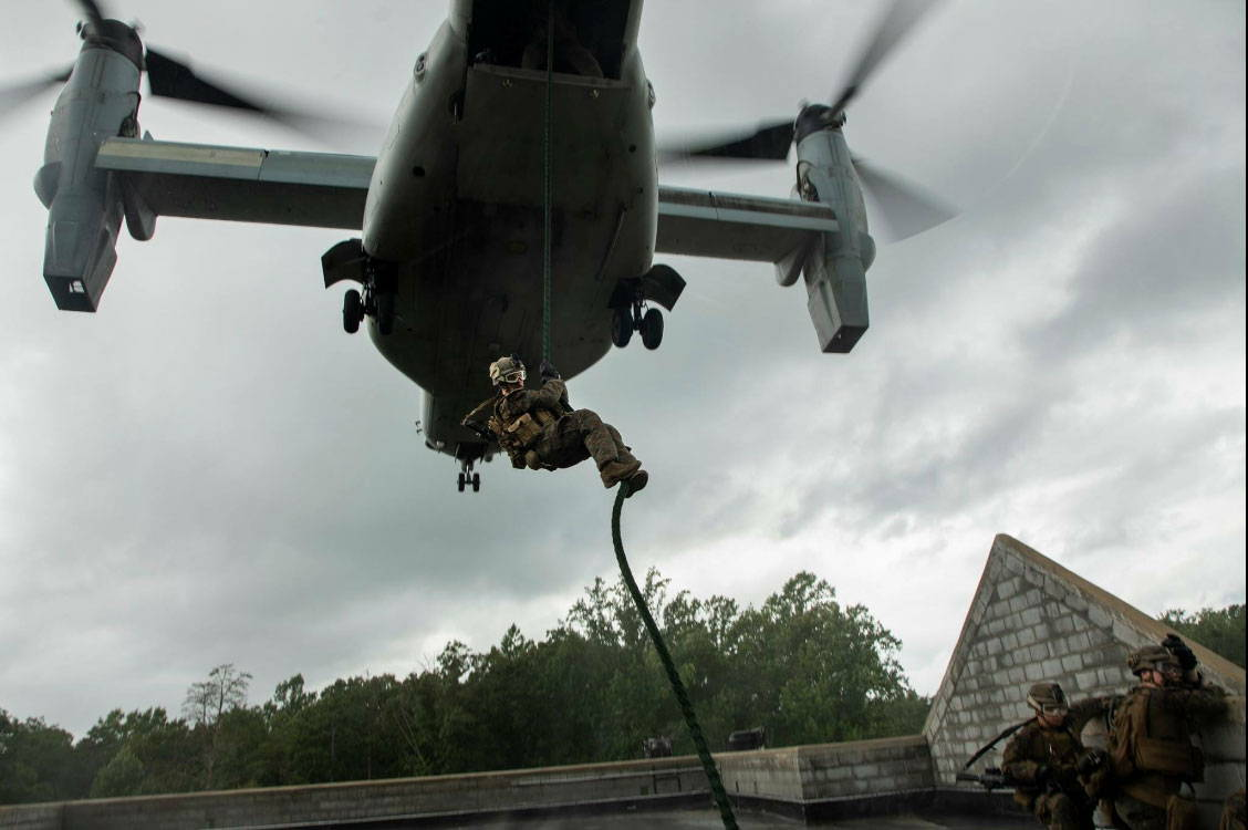 Marine Corps Soldier Fast Roping from Osprey Aircraft