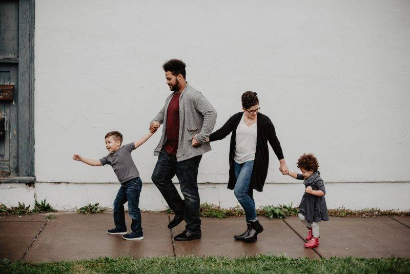 Family Walking Down The Road