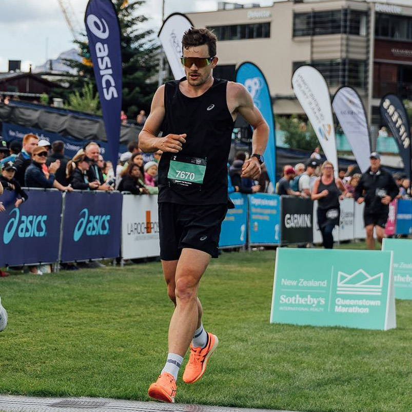 Mike Phillips crossing the finish line of the Queenstown Marathon
