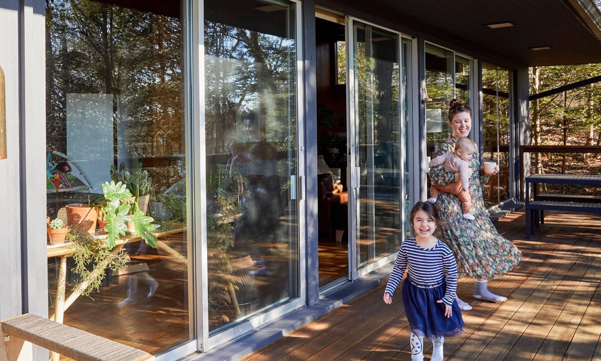 Kate Jordan outside her midcentury modern home.