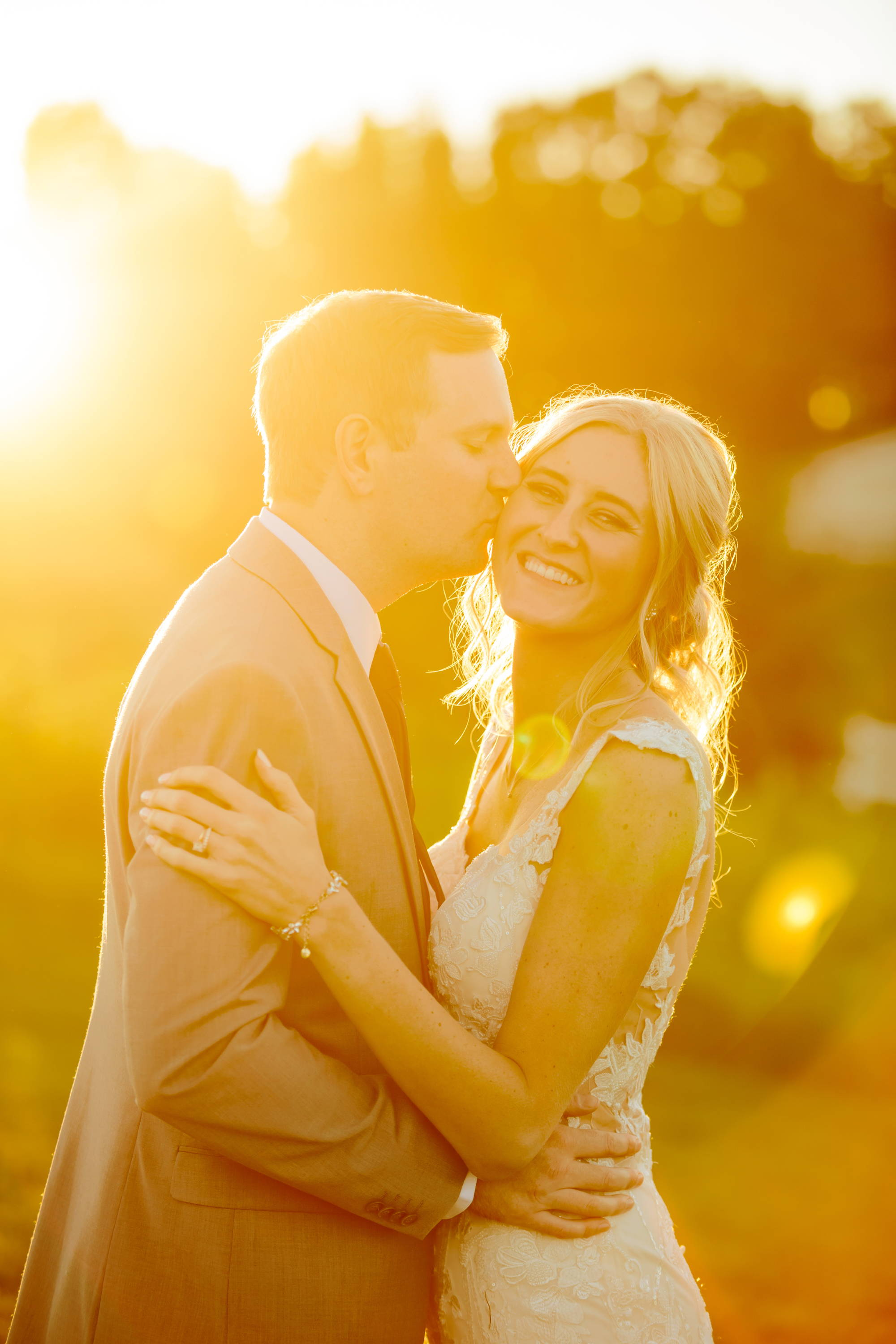 Henne Engagement Ring Couple Scott & Sarah Share a Kiss Under the Sunset