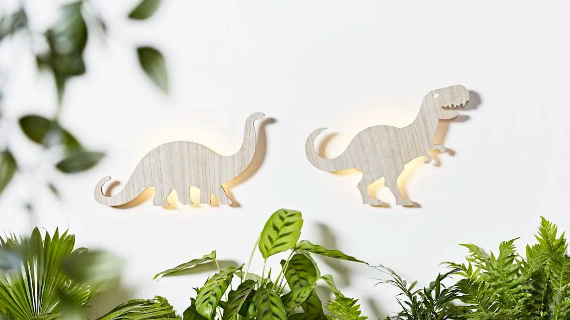Dinosaur children's wall lights illuminated on wall