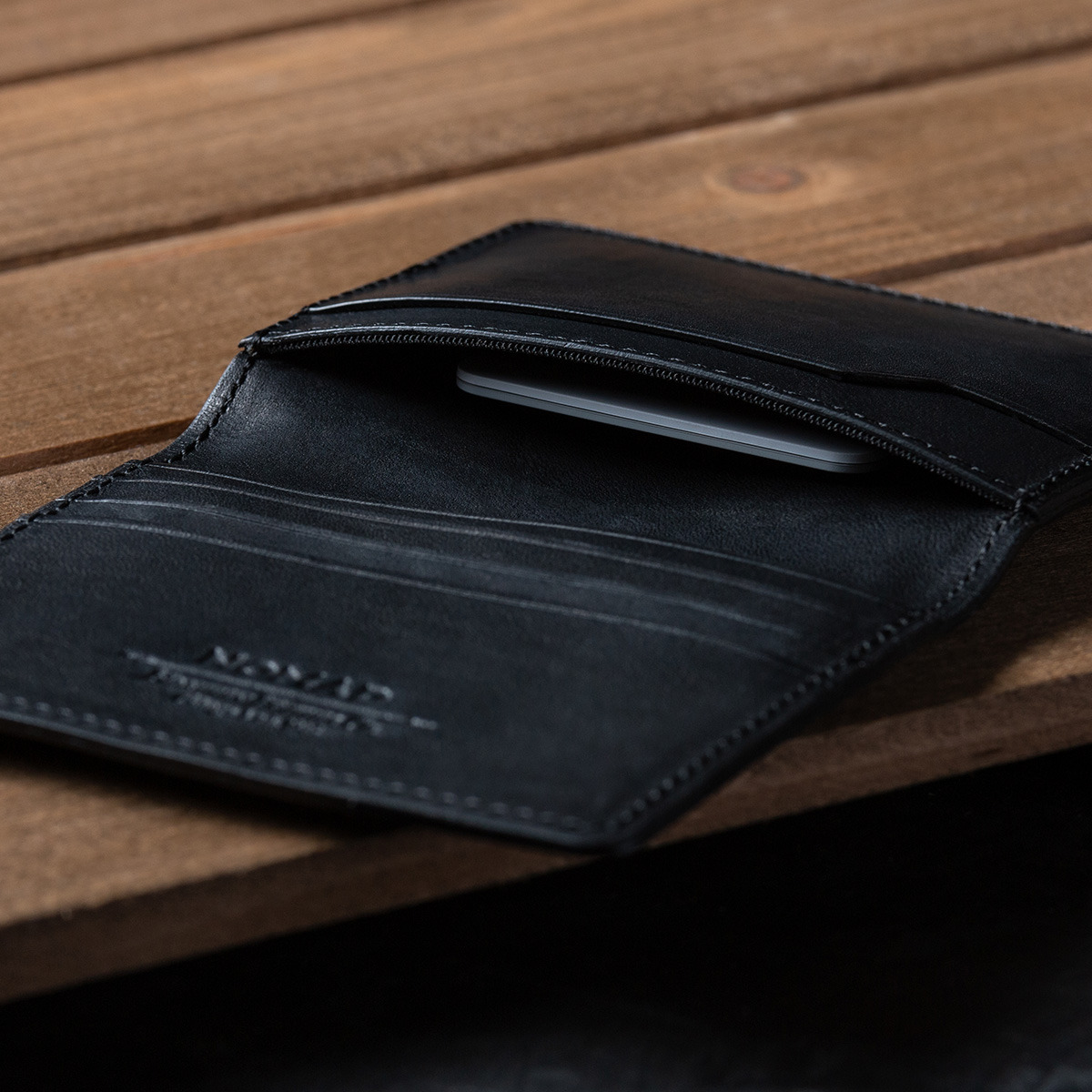 black Nomad Tile Wallet's stealth pocket where the Tile tracker is securely hidden