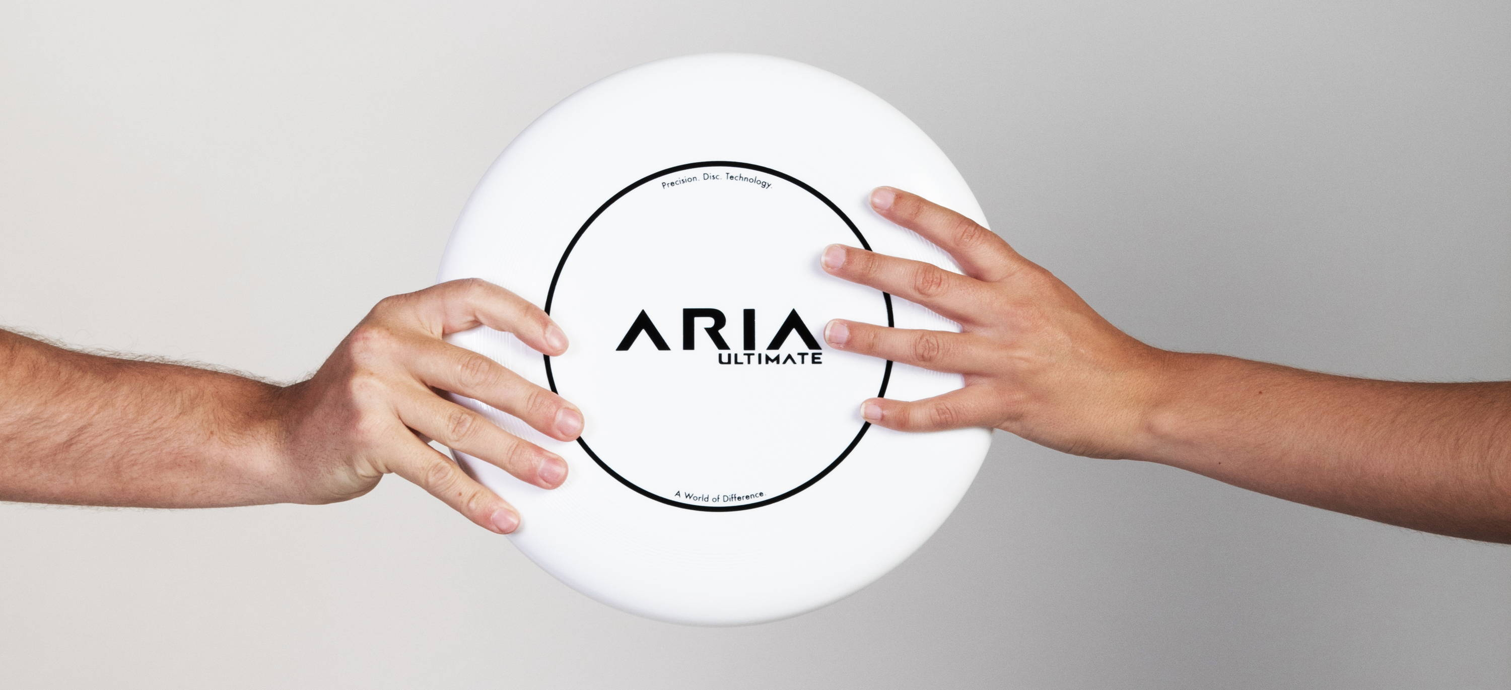 ARIA professional official ultimate flying disc for the sport commonly known as 'ultimate frisbee'  two hands catching a disc