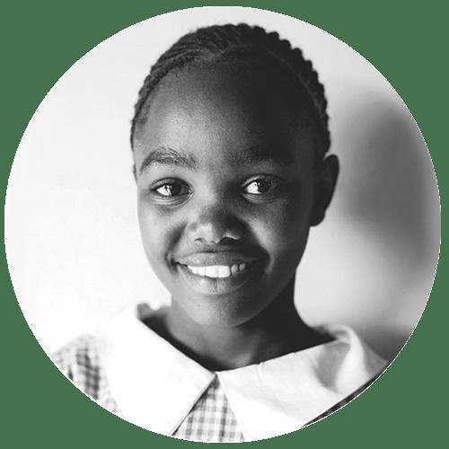 A young Kenyan girl smiling at the camera