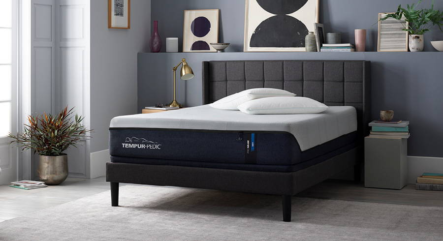 Upholstered bed frame and Tempur-Pedic mattress in a modern bedroom.