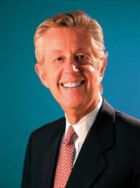 Photo of a smiling blonde Man wearing a suit