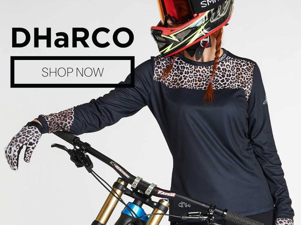 Woman wearing a Dharco leopard print mountain bike jersey