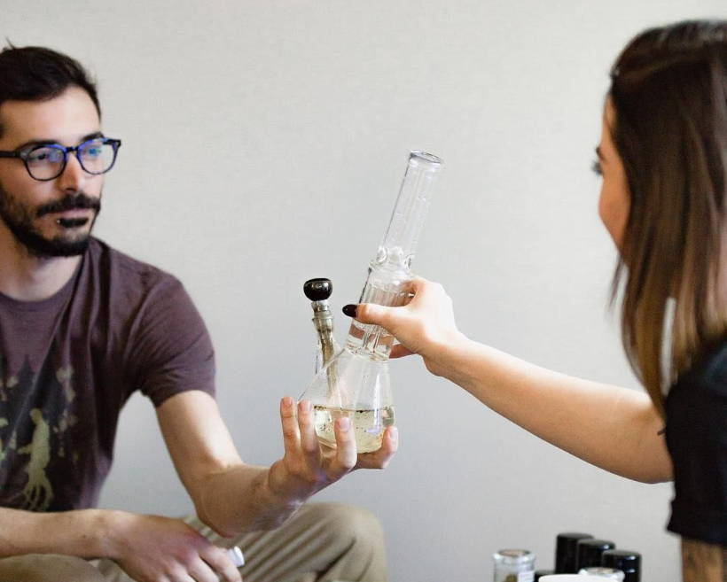 People smoking a Beaker Base Glass Bong with removable downstem