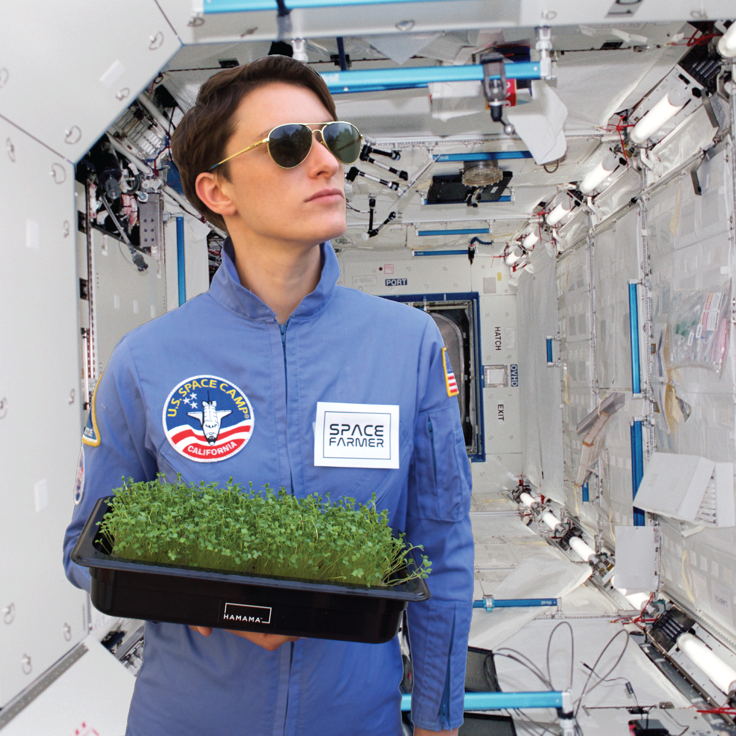 Woman carrying a grow tray of fully grown microgreens dressed as an astronaut in space.