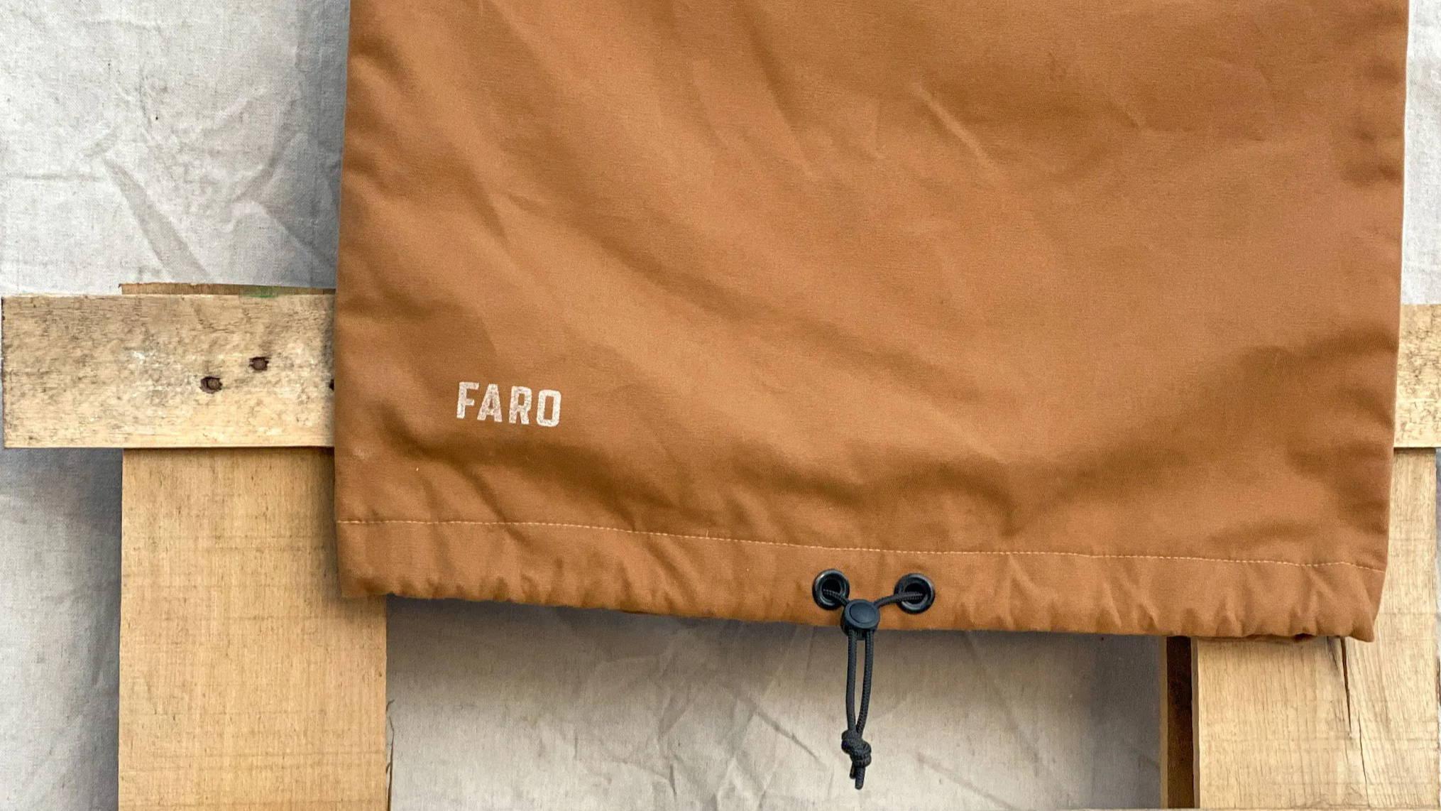 brown surfboard bag hanging