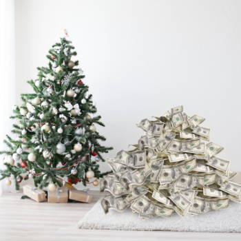 a christmas tree next to a pile of 100 dollar bills