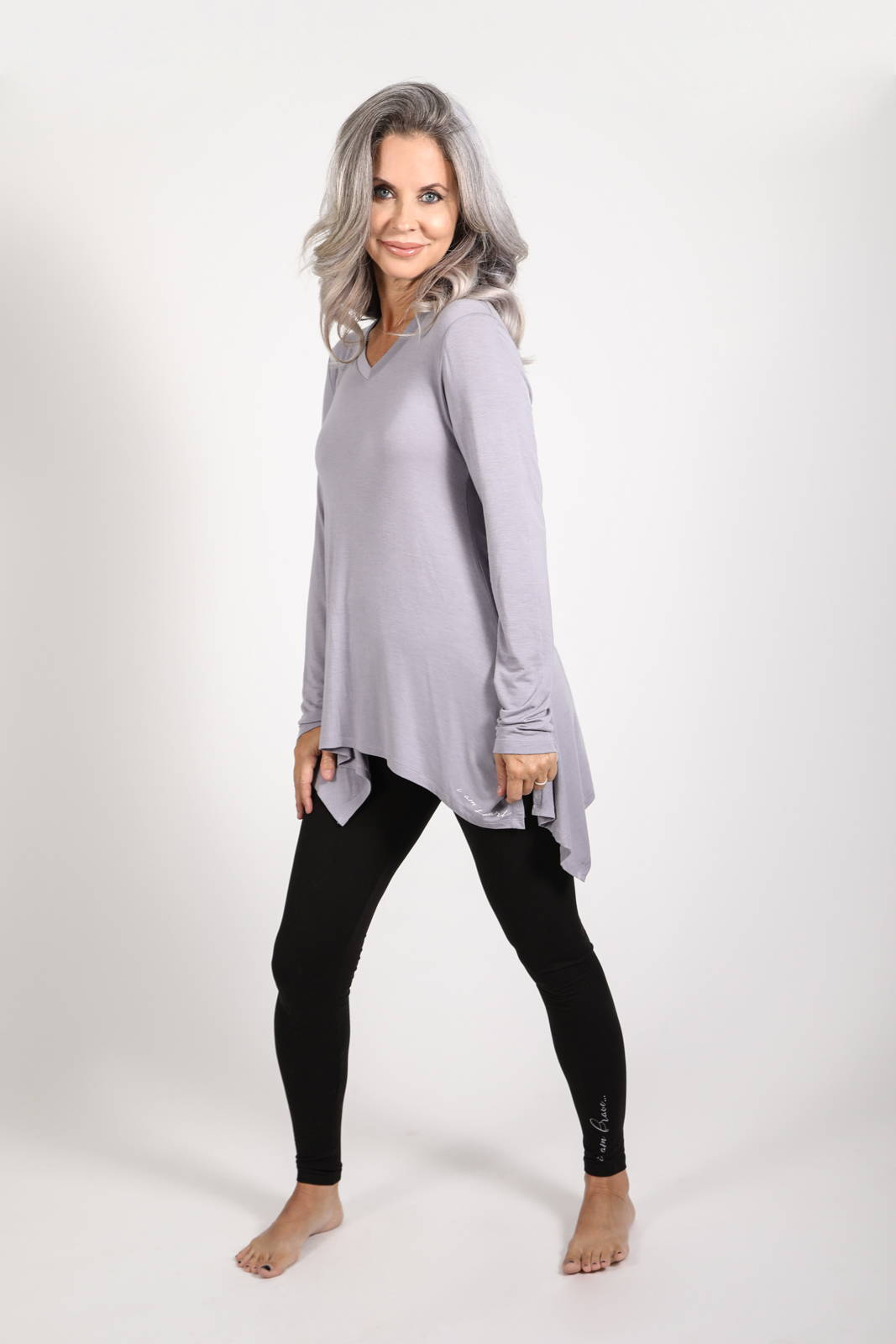 Model wearing the Solas Top in Lavender Grey and the Lumo Legging
