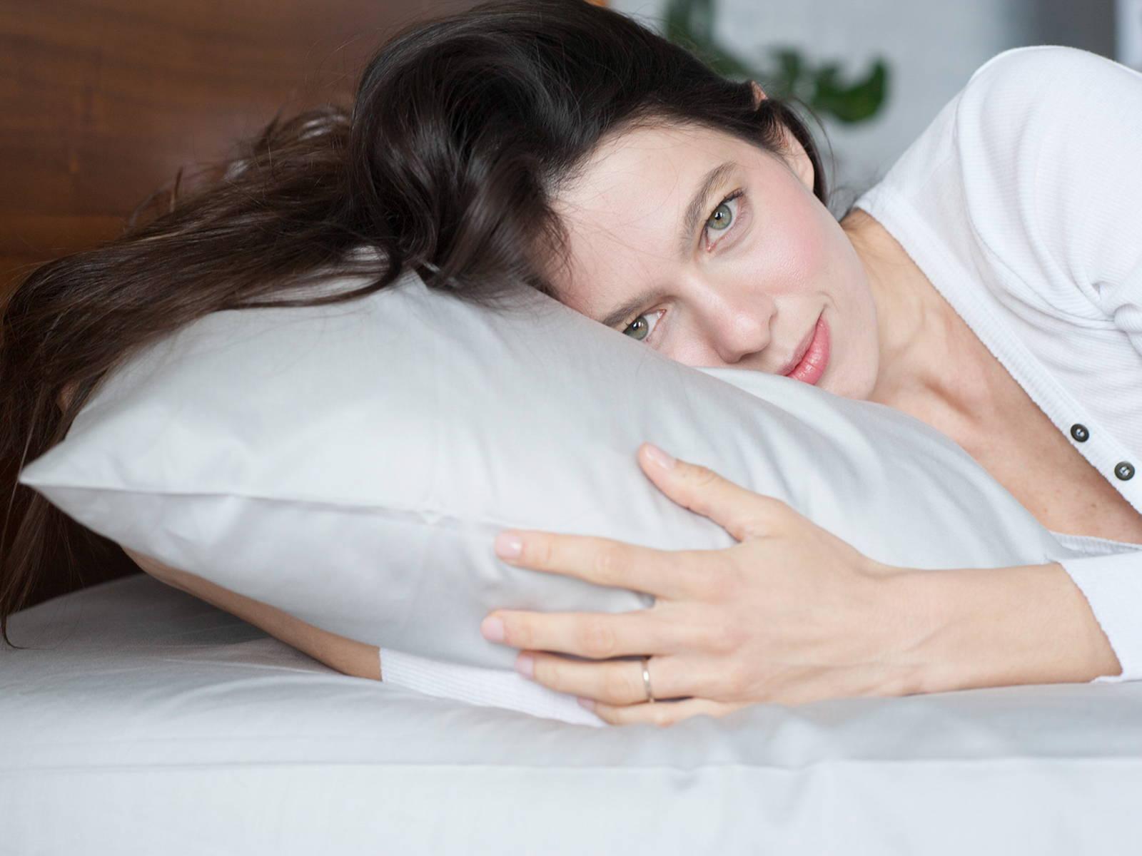 girl resting on luxury organic cotton light gray pillowcase