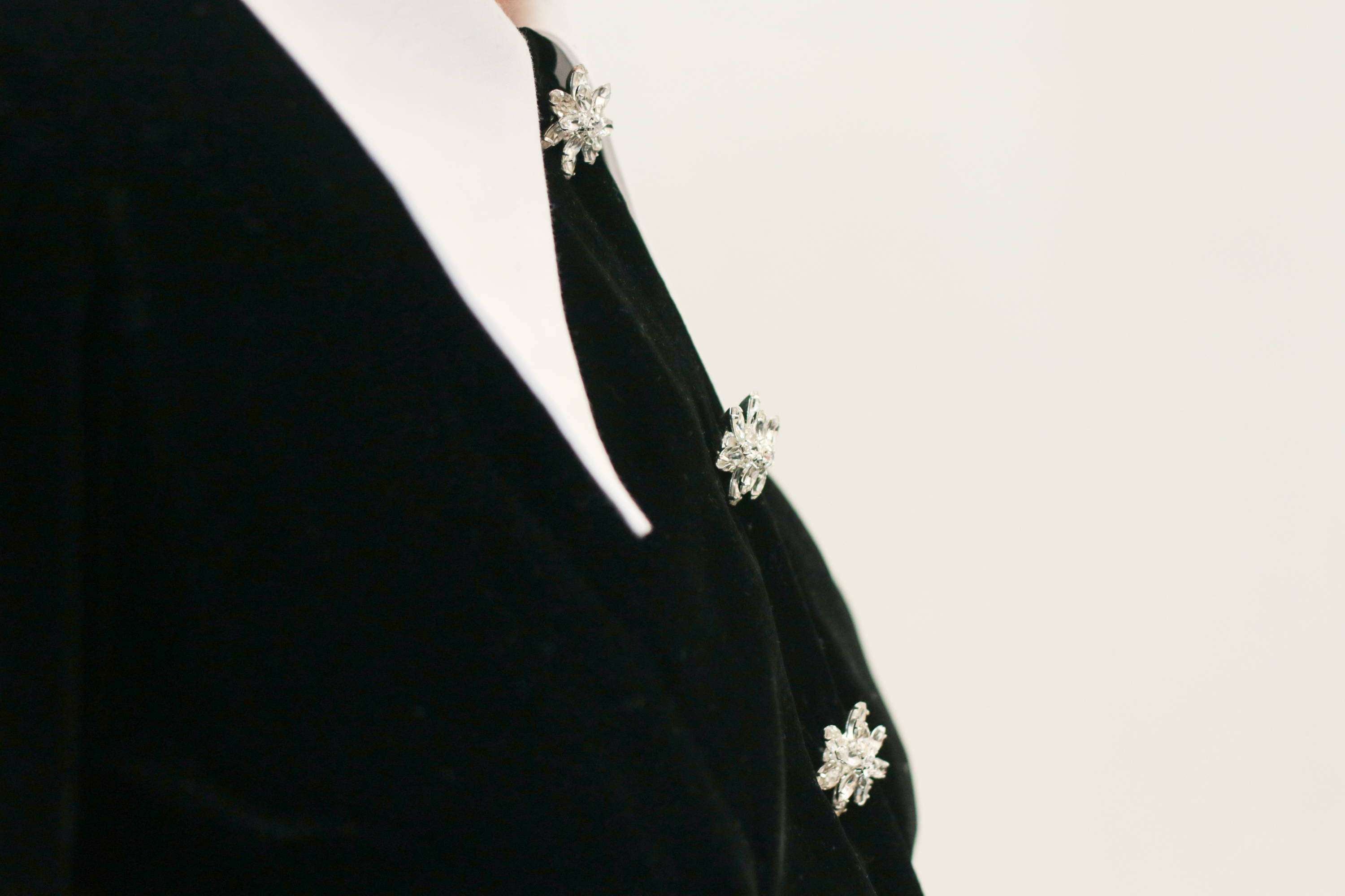 The maternity friendly Laurel dress in black velvet with the detachable collar and handcrafted buttons