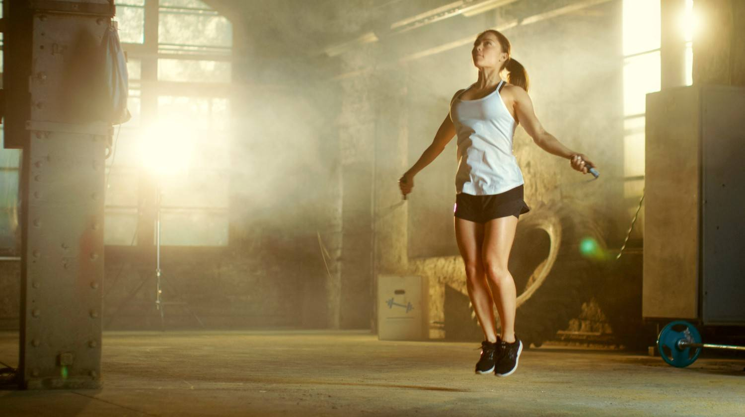 Athletic Beautiful Woman Exercises with Jump Rope in a Gym | Best Jump Rope Workout Routines To Burn Stubborn Fat | jump rope hiit workout | Featured