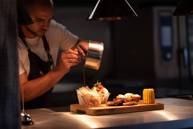 a man preparing a dish