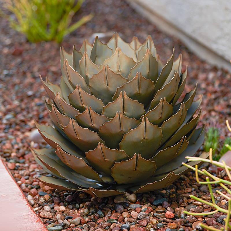 Steel Artichoke Agave in flower bed