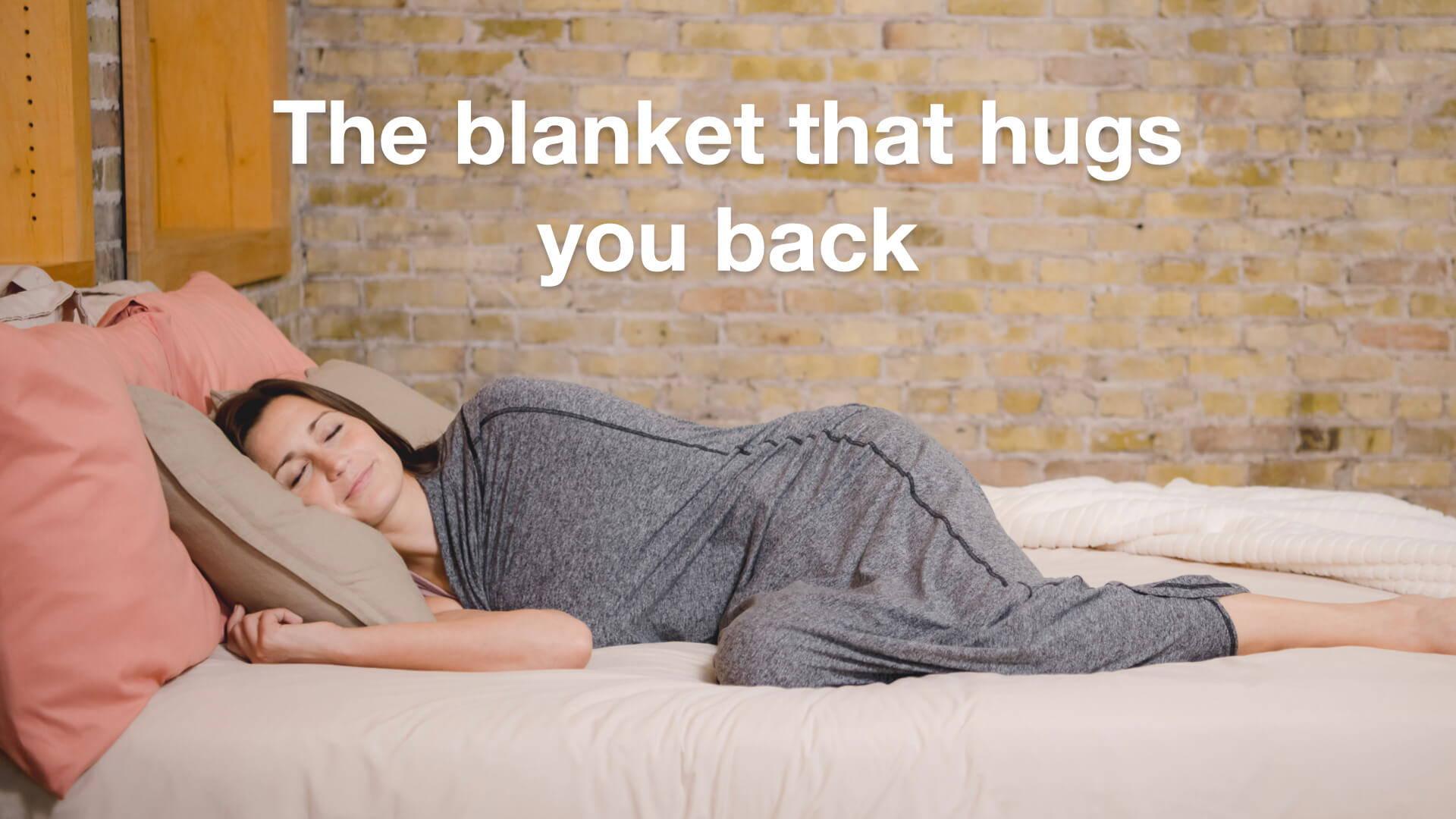 The blanket that hugs you back - woman in sleep pod sleeping on bed